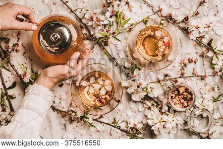 Female Hands Serving Black Tea With Rose Flowers, Top View