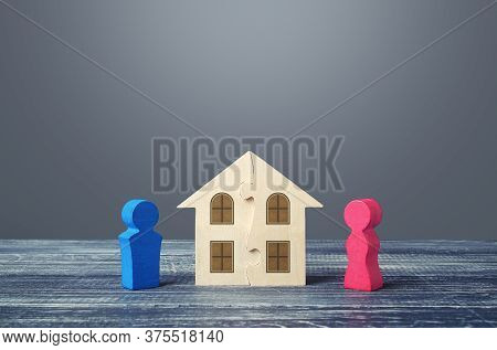 Figures Of Husband And Wife And House Puzzle. Marriage Contract. Buying Or Building A Dream Home. Di
