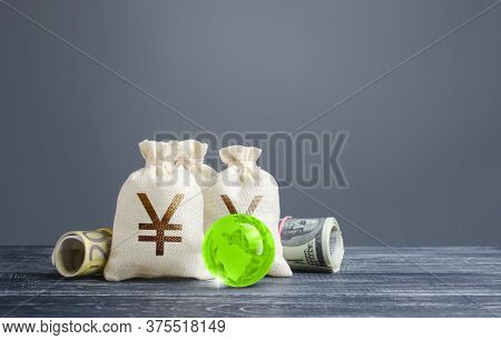 Yen Yuan Money Bags. Banking Financial System, World Reserve Currency. Economics, Lending Business.