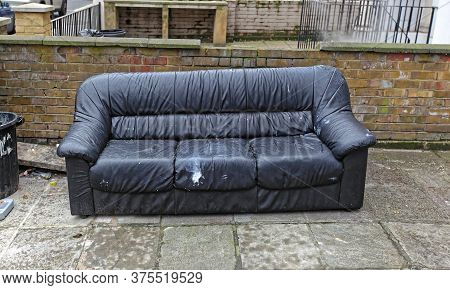 Old Sofa Waiting For Rejected Furniture Collection