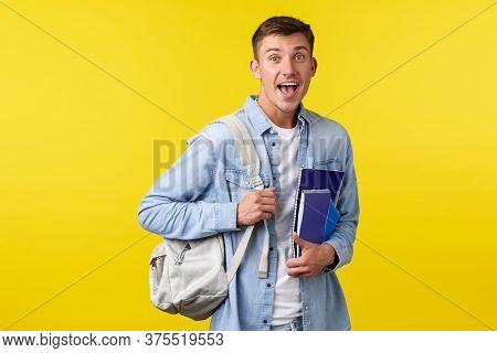 Education, Courses And University Concept. Surprised Happy Smiling Guy Seeing Something Amazed While
