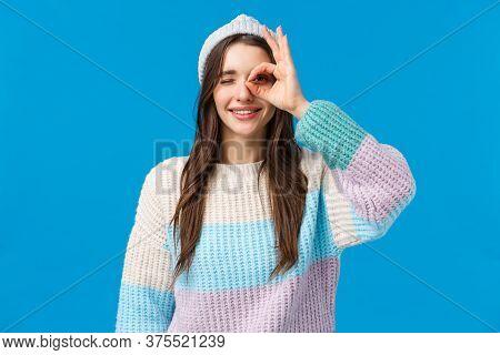 Waist-up Portrait Cheerful Beautiful Brunette Woman In Winter Sweater, Hat, Showing Okay, Good Gestu