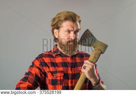 Bearded Man Holds Old Ax. Canadian Lumberjack. Bearded Man With Old Ax. Bearded Man With Old Ax In H