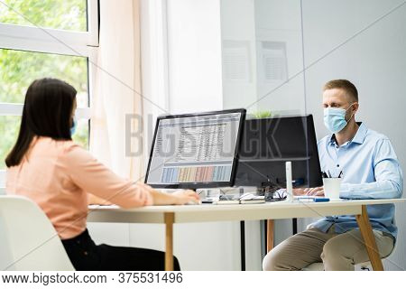 Business Employee Social Distancing Using Sneeze Guards In Office