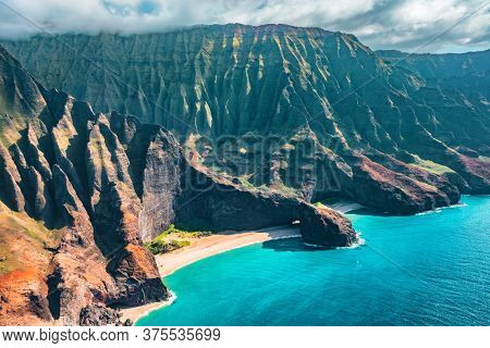 Napali coast on Kauai North shore island, Hawaii. Aerial view of famous landscape with beach, mountains and rugged ridges.