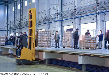 St. Petersburg, Russia - November 21, 2008: Loading And Unloading Operations Inside The Warehouse, A