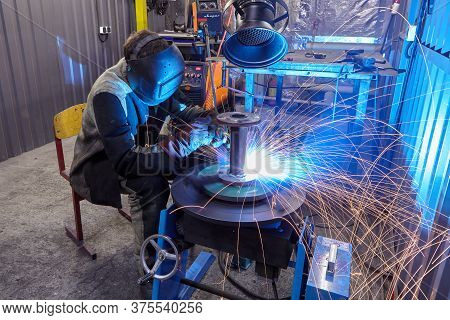St. Petersburg, Russia - December 24, 2018: Welding Work On Steel Structures Plant, Welder Welds Met