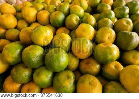 orange fruit stacked on the marketplace at Taiwan
