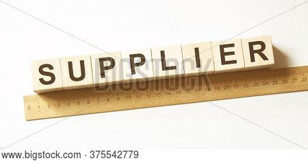Word Supplier Made With Wood Building Blocks
