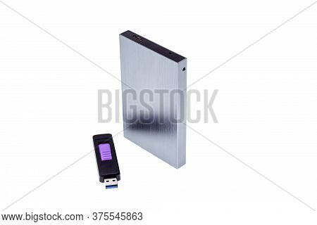 Flash Memory And Usb 3.0 Portable External Hard Drive Isolated On White Background Close-up