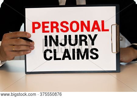 Personal Injury Claim Written On Color Sticker Notes Over Cork Board Background.
