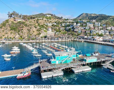 Pier Of Avalon Bay In Santa Catalina Island, Famous Tourist Attraction With Little Shops In Southern