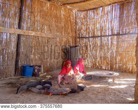 Bedouin Village In Desert, Egypt - February 2020: Bedouin Shack Made Of Wood And Yellow Cane, Medium