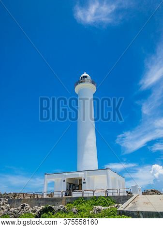 Summer Refreshing Blue Sky And Cape Zanpa Cape Lighthouse And Sea, A Tourist Spot In Okinawa