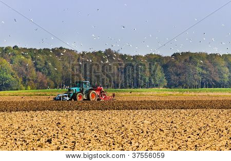 Agriculture - Plough Up The Field With Tractor