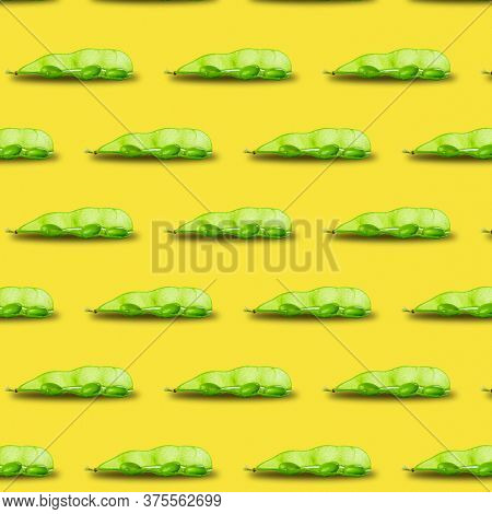 Edamame Or Soybeans Pod Pattern Isolated On Yellow Background.