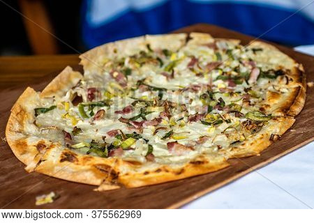 Tarte Flambee, Atraditional French Dish. Fresh Baked In A Wood-fired Traditional Adobe Oven Flame Ca