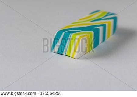 Multi-colored Eraser On A Light Background. Close Up. Selective Focus