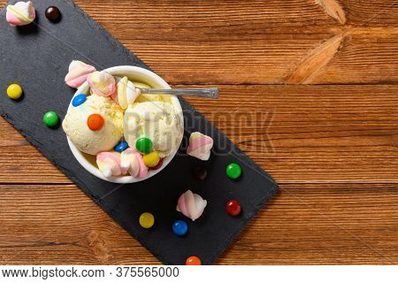 Top View Fresh Vanilla Flavor Ice Cream Sundae With Chocolate Buttons And Marshmallows