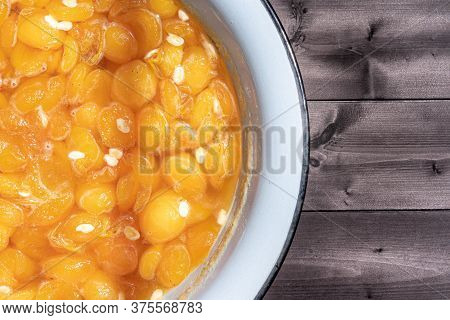 Apricot Jam On A Wooden Background.apricot Jam On A Wooden Background