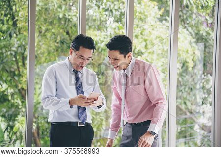 Success Businessman Happy Got Good News From Mobile Smart Phone That Business So Success. Asian Youn