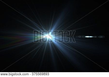 Bright Beam Of A Searchlight On A Dark Background. Light From A Lamp In The Dark.flash