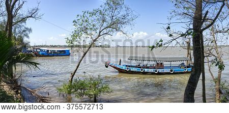 My Tho, Mekong Delta, Vietnam - February 13, 2019:  Traditional Colorful Vietnamese River Boats On T