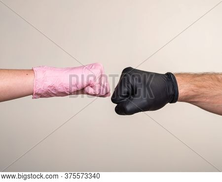 Greeting Fist To Fist In Medical Rubber Gloves