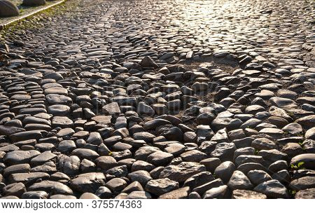 Cobblestone Pavement In The City. Cobblestone Street Surface At Sunset