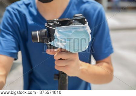 Gimbal Operator With Black Equipament - Stabilizer And Camera Filmmaking . An Unidentified Man Holdi