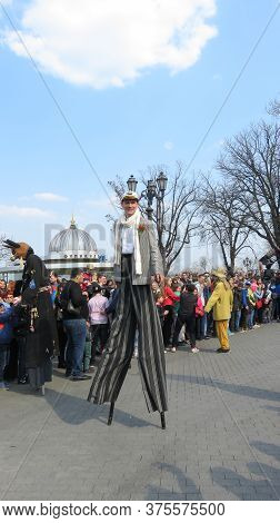 Odessa, Ukraine - 04 01 2019: Tall And Funny Clowns Entertain Gathered People On The Occasion Of Apr