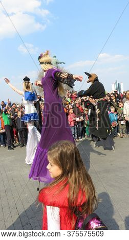 Odessa, Ukraine - 04 01 2019: Funny Tall And Funny Clowns Dance To Music And Entertain People On The