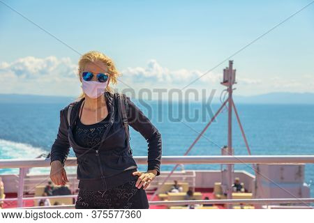 Woman On Ferry Boat With A Surgical Mask During Covid-19. Italian Tourist Woman Travels On Tyrrhenia