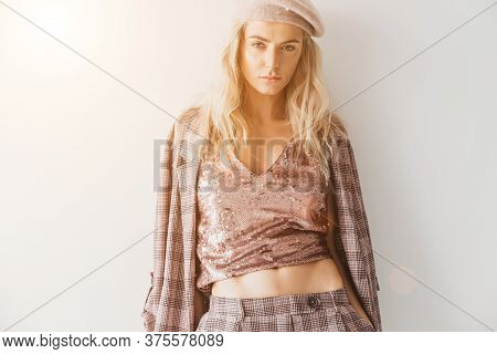 Portrait Of Wonderful Young Blonde Woman With Long Hair Looking At Camera, Smiling. Fashion Stylish