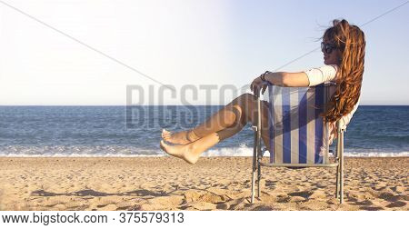 Summer Beach Vacation Concept, Cheerful Young Woman With Sunglasses With Long Ginger Hair Smiling An