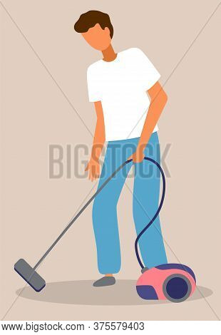 Young Guy Cleaning Floor From Dirt With Vacuum Cleaner. Home Everyday Activity During Quarantine Tim