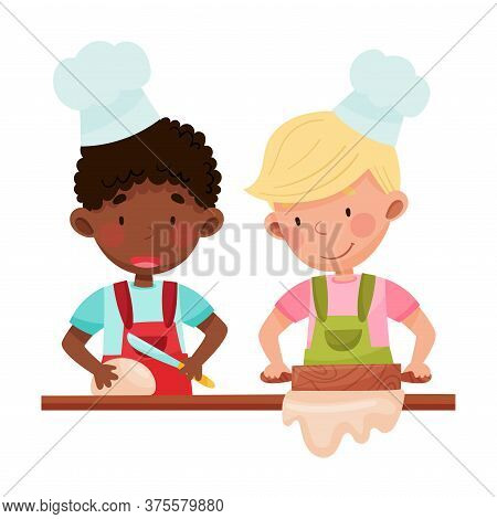 Cute Boy Chef Characters Wearing Apron And Hat Rolling Out Dough Vector Illustration