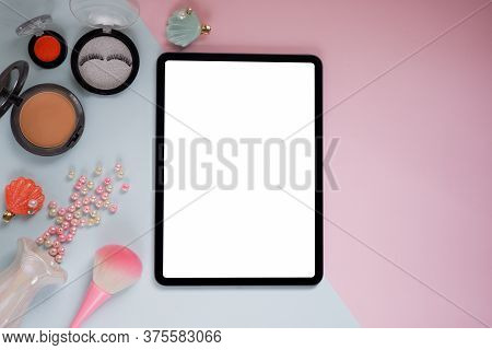 Top View Image Of White Blank Screen Computer Tablet On Table Two Tone. Women Space In Office.