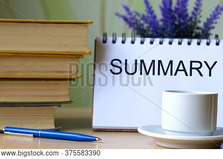 Summary - Word In A Notebook Against The Background Of Old Books With Pen And White Cup. Education C