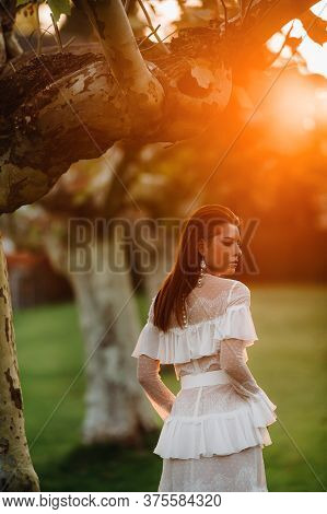 A Bride In A White Wedding Dress With A Belt In The Old Town Of Velden Am Werter See.a Model In An A