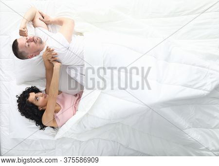 Man And Woman Swear In Bed. Family Psychology Concept