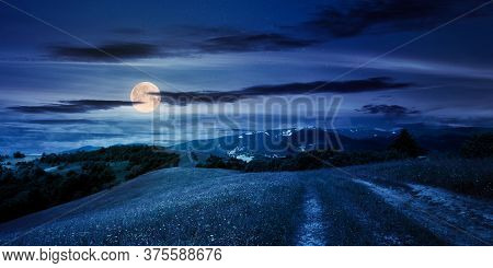 Path Through The Mountain Meadow At Night. Mysterious Summer Landscape Of Carpathian Countryside In