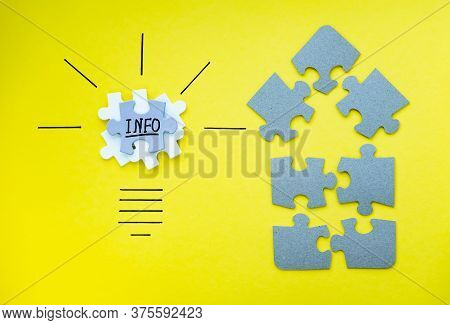Light Bulb And Home Over Yellow Background In Vision And Idea Conceptual Image. Conceptual Image Of