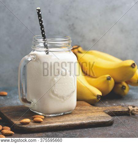 Vegetarian Vegan Almond Banana Smoothie In Glass Jar. Healthy Protein Smoothie Of Banana