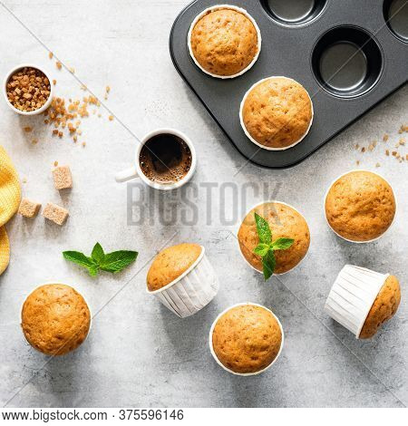 Vanilla Caramel Muffins In Paper Cups On Concrete Backdrop, Top View. Baking Muffins Process, Food R