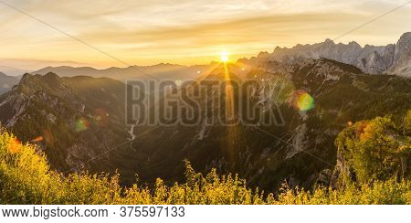 Amazing Sunrise In The Mountains. Backlight Sunlight With Beautiful Lens Flares And Sunbeams. Panora