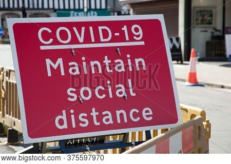 Maintain Social Distance Sign For Covid 19 In Stratford Upon Avon In Warwickshire In The Uk. Taken O