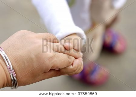 Mom and kid hands