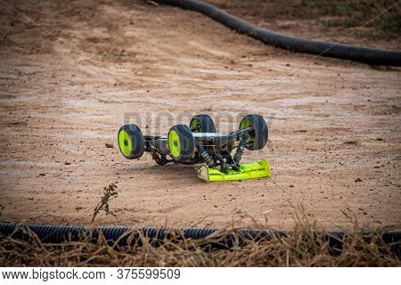 Rc Buggy Upside Down After Tumbling At The Outdoor Track