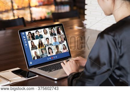 Back View Of Young Asian Business Woman Work Remotely At Home Video Conference Remote Call To Corpor